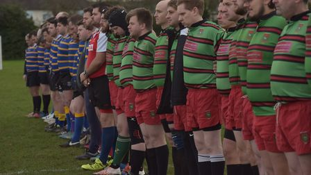 Players observe a minute of silence ahead of the game Picture: SONYA DUNCAN