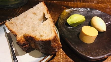 Homemade sourdough with mugwort and chive, chicken fat and Marmite butter Picture: Charlotte Smith-