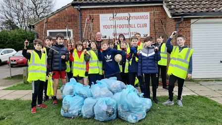 Players from Cornard Dynamos Under 13s football team with the litter they collected. Picture: ROSS B