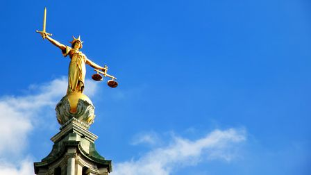 The scales of justice statue at the Old Bailey in London