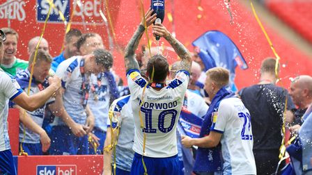 James Norwood celebrates promotion following Tranmere's victory in the League Two play-off final in