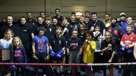 Members of Eastgate Boxing Club face the camera Picture: RACHEL EDGE