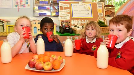 Mollie, Haneef, Guy and Lennon with their glass bottles of milk Picture: CHARLOTTE BOND
