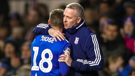Town manager Paul Lambert embraces Alan Judge after taking him off late in the game. Picture Steve