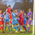 Josh Kerridge (number 6) rises above the Hullbridge defence to head a corner high into the oppositio