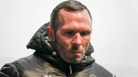 Lincoln City team manager Michael Appleton walks from the pitch at half time. Picture Steve Waller