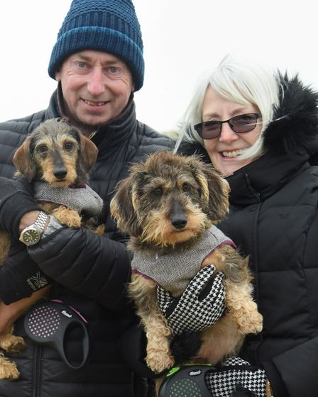 Millie, four, left, and Albert, three, ready for the Southwold Sausage Dog Walk with owners Mark and