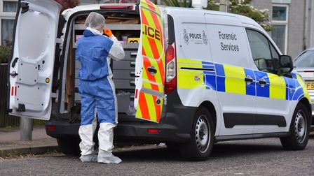Forensic officers at Victoria Road in Lowestoft following the attack Picture: Jamie Honeywood