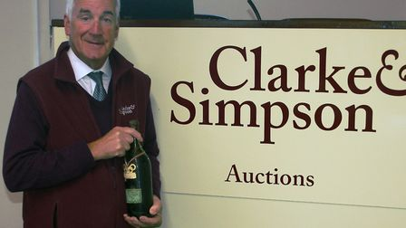Auction centre manager Geoffrey Barfoot with the bottle of 1968 Chartreuse VEP PIcture: JAMES SHAND