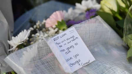 Flowers and messages left near to the scene where a man, named locally as Liam Taylor 19, died after
