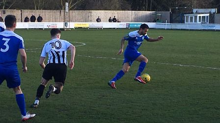 Ex-Ipswich Town star Carlos Edwards, on the ball against Dereham Town this afternoon, Picture: CARL