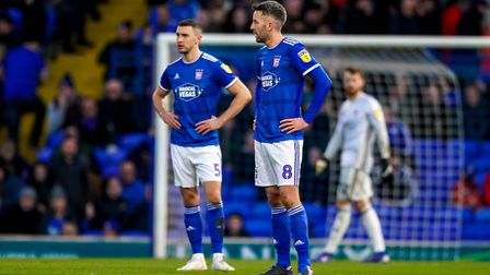 James Wilson and Cole Skuse with hands on hips after Town had conceded their fourth goal to Peterbor