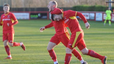 Billy Hunt, right, is congratulated by Adam Mills after scoring in Needham Market's 4-3 win over Hed