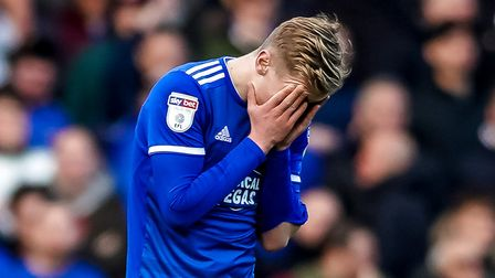Flynn Downes with his head in his hands after Town had gone two goals behind. Picture Steve Waller