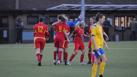 Needham Market Women celebrate one of their four goals in their win at Newmarket Town Photo: BEN POO