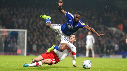Kane Vincent-Young is fouled by Trevor Clarke in the Portman Road clash. Photo: Steve Waller