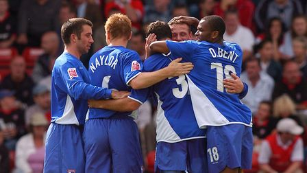 Shefki Kuqi is mobbed after scoring during the first half of Ipswich Town's last ever visit to Millm