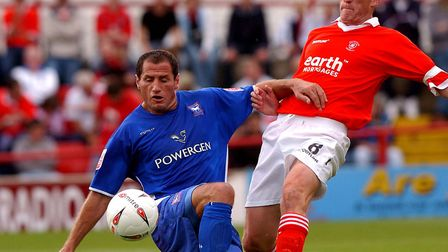 Shefki Kuqi, in action at Rotherham from 16 years ago, battling for possesion with Chris Swailes. Ku