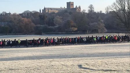 St Albans Cathedral towers over a procession of runners and walkers at the St Albans parkrun. Pictur