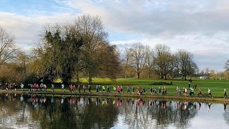 Runners alongside the lake at the St Albans parkrun, in Verulamium Park. Picture: ST ALBANS PARKRUN