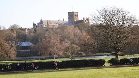 St Albans Cathedral in the background, as runners take part in the weekly St Albans parkrun. Picture