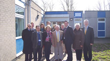 This image includes Ernie Broom (centre) and councillor Paul Hopfensperger (far right) in front of t