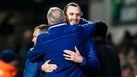 Will Keane and manager Paul Lambert embrace after Ipswich Town's 1-0 win against Lincoln. Photo: Ste