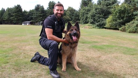 Pc Chris Squirrell with Daley, who discovered a missing man in freezing conditions in Belstead Pictu