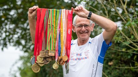 London Marathon Ever Present runner Mac Speake, 78, with his collection of race medals, at his home