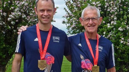 Bill Speake, left, and his father Mac Speake with their medals after completing Sunday's London Mara