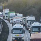 Funding to aid traffic problems on the A14 in Suffolk are linked with a requirement to build 30,000