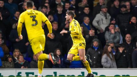 Ched Evans wheels away after scoring to give Fleetwood a 1-0 first half lead. Picture Steve Waller
