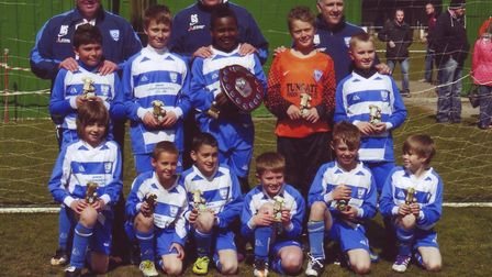 Tyreece Simpson (captain) pictured with Breydon U10s after they won the Norfolk and Suffolk Youth Le