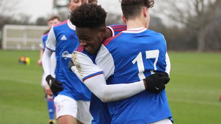 Tyreece Simpson celebrates with Lounes Foudil as Town U18s beat Millwall 5-3 at Playford Road. Pictu