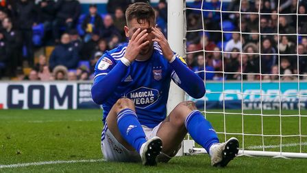 Skipper Luke Chambers has his head in his hands during the defeat to Coventry. Photo: Steve Waller