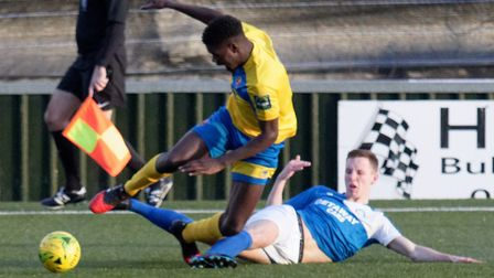 Joe White (blue shirt) is set to return for Bury Town this weekend, after missing last Saturday's ho