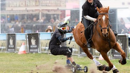 High action in the main arena with UK Horseboarding at the East Anglian Game and Country Fair at the