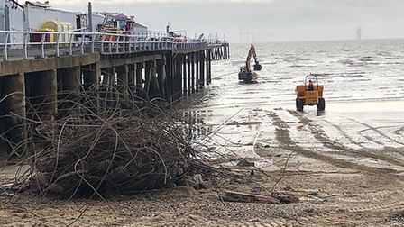 Steelwork from Clacton Pier is being dragged from the North Sea as part of clean-up efforts Picture: