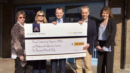 Joshua Hopkins presents a £10,000 donation to the winners of the Hopkins Homes Suffolk Charity vote