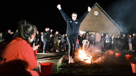 More than 60 people braved the heat to walk across hot embers and raise thousands of pounds for Suff