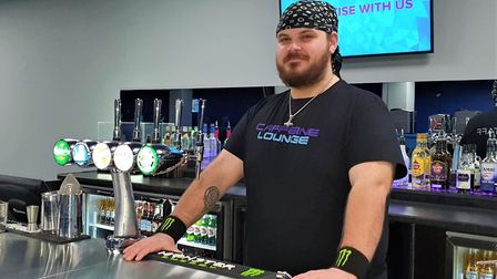 Sean pictured working behind the bar is one of 14 employees at Caffeine Lounge. Picture: GEMMA JARVI