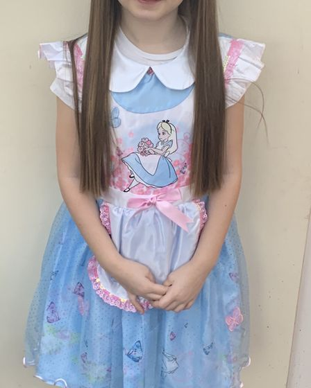 Mia, age 8, dressed up as Alice from Alice in Wonderland Picture: JENNY MAYHEW