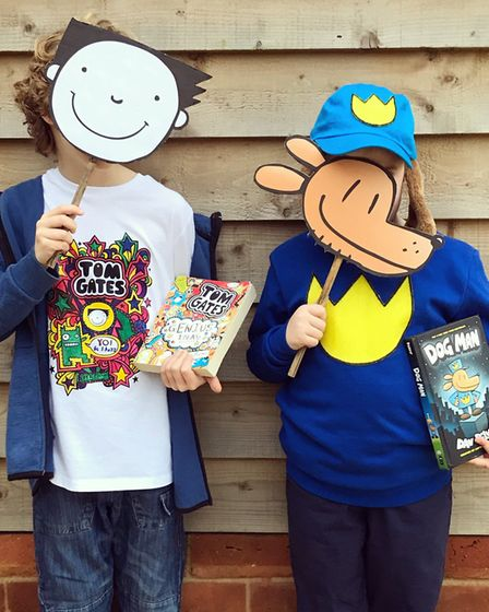 Beckett and Orla Gates, aged 8 and 6, dressed up as Tom Gates and Dog Man Picture: TRUDI WILD