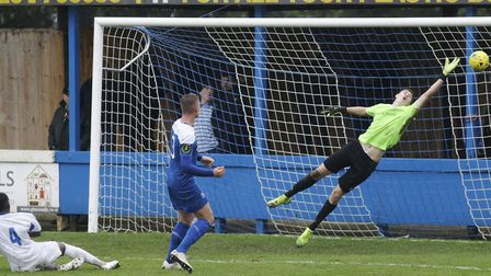 Bury Town keeper Dan Barden, at full stretch to try and keep out an effort by Romford's Inesh Sumith
