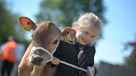 Young handler Charlotte Bolderston, aged 6 with Pippet, at the 2019 Suffolk Show Picture: SARAH LU