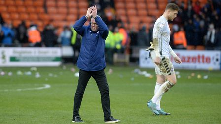 Town Manager Paul Lambert applauds the travelling supporters after the last gasp defeat at Blackpool