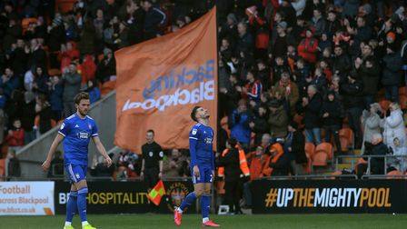 Luke Garbutt is disappointed with his mistake which led to the first goal at Blackpool. Picture Page