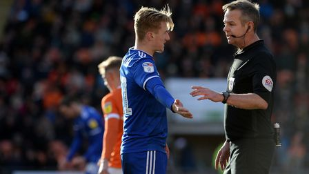 Flynn Downes aims to negotiate with the referee at Blackpool. Picture Pagepix Ltd