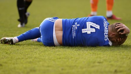 Luke Chambers in pain after a challenge during the first half at Blackpool. Picture Pagepix Ltd