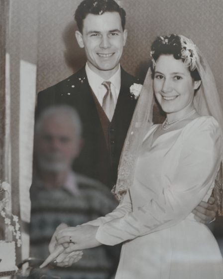 Ron Joyes reflected in his wedding photograph. Picture: CONTRIBUTED